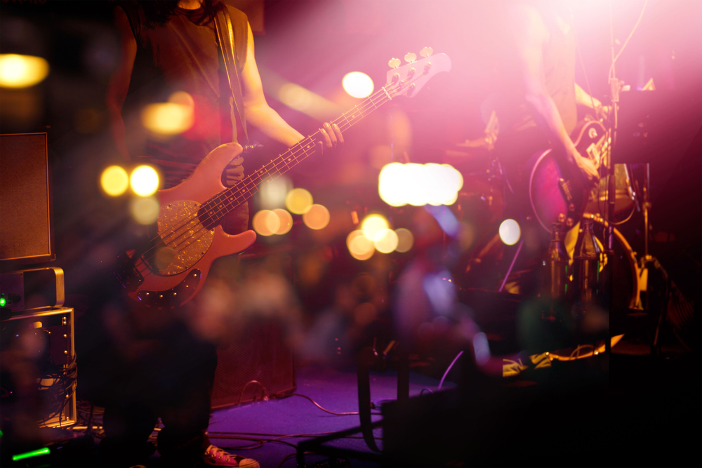 Independent artist on stage with guitar
