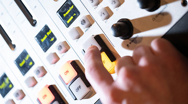 person pressing buttons on audio equipment