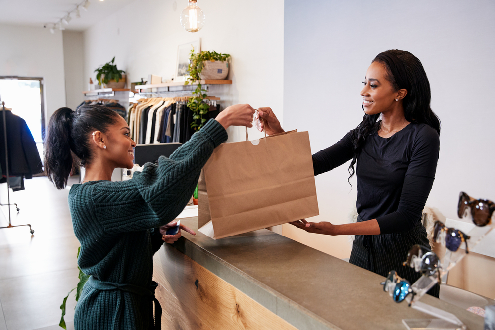 Happy and satisfied customers buying products in-store